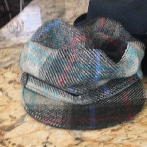 Three hats - ladies. Two newsboy, one fedora.